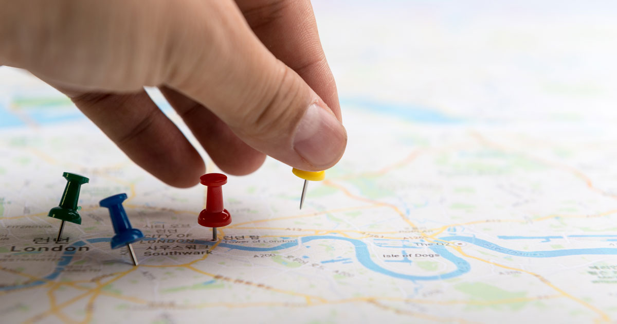 Thumbtacks on a travel map