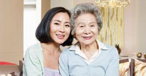 Woman with her grandmother smiling for camera