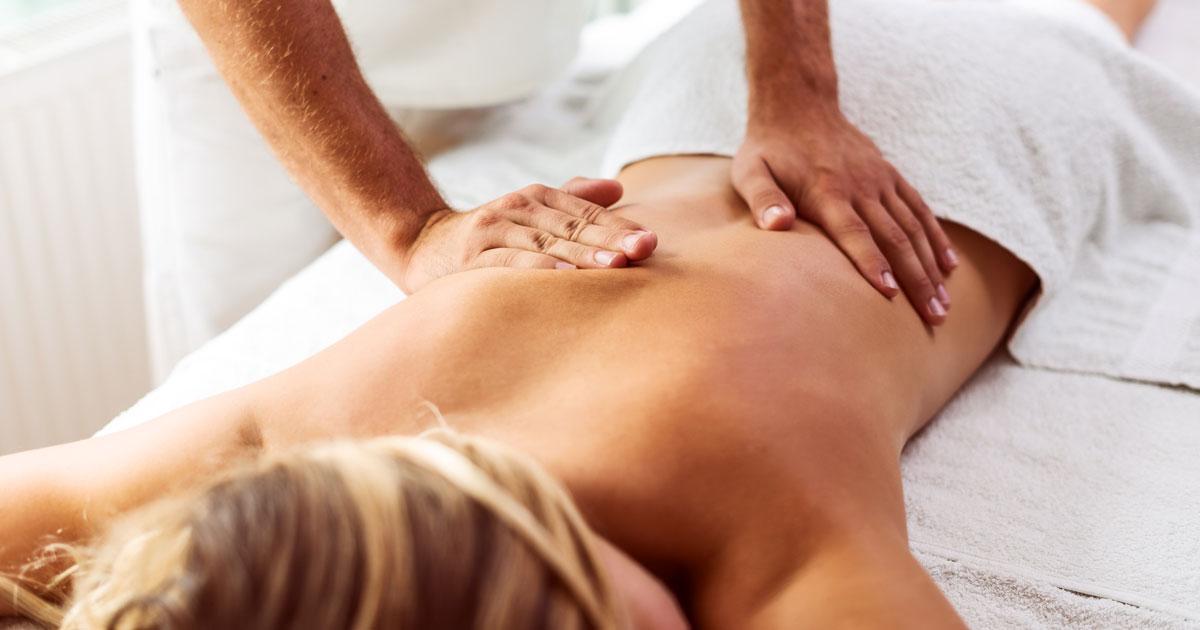 Woman lying on massage table getting a massage