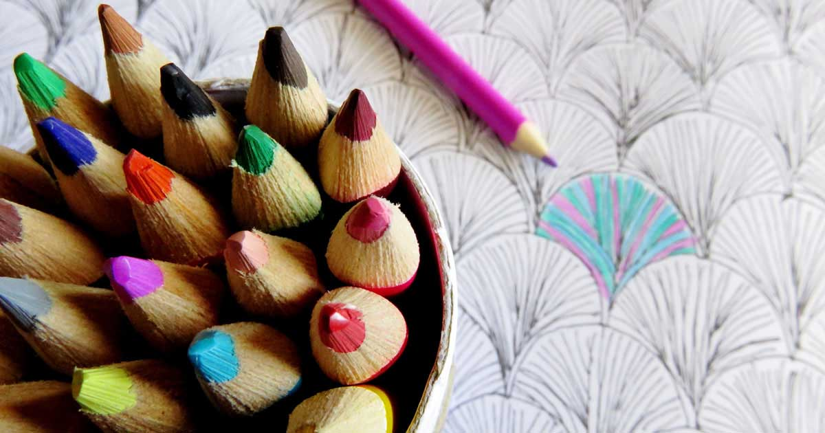 Colouring book with pencil crayons