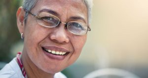Older woman is smiling
