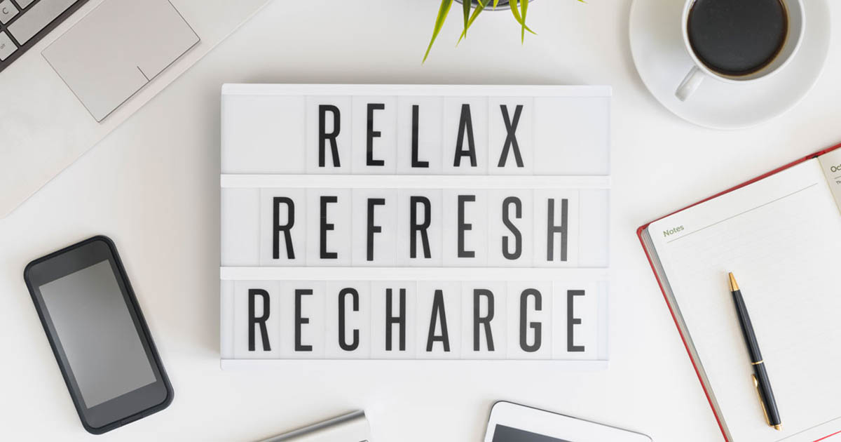 "A sign that says ""Relax, Refresh, Recharge"" on it"