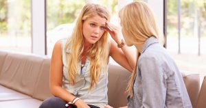 Frustrated friend talking to another friend