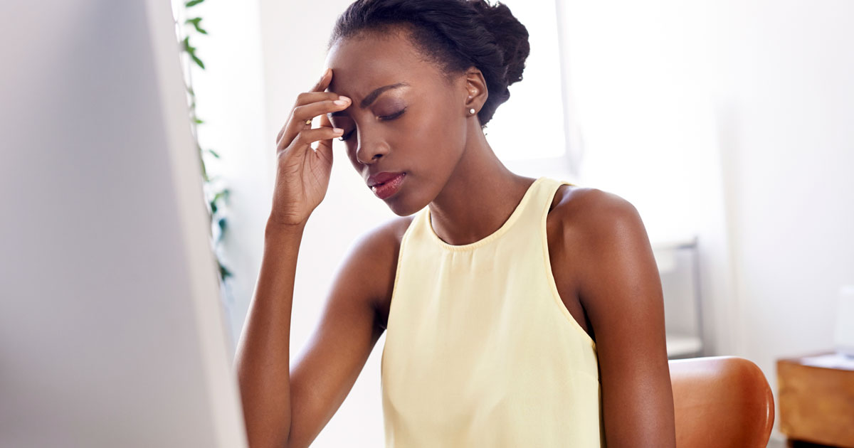 A woman is experiencing head pain