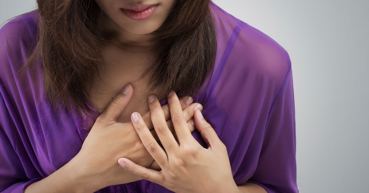Woman is experiencing chest pain