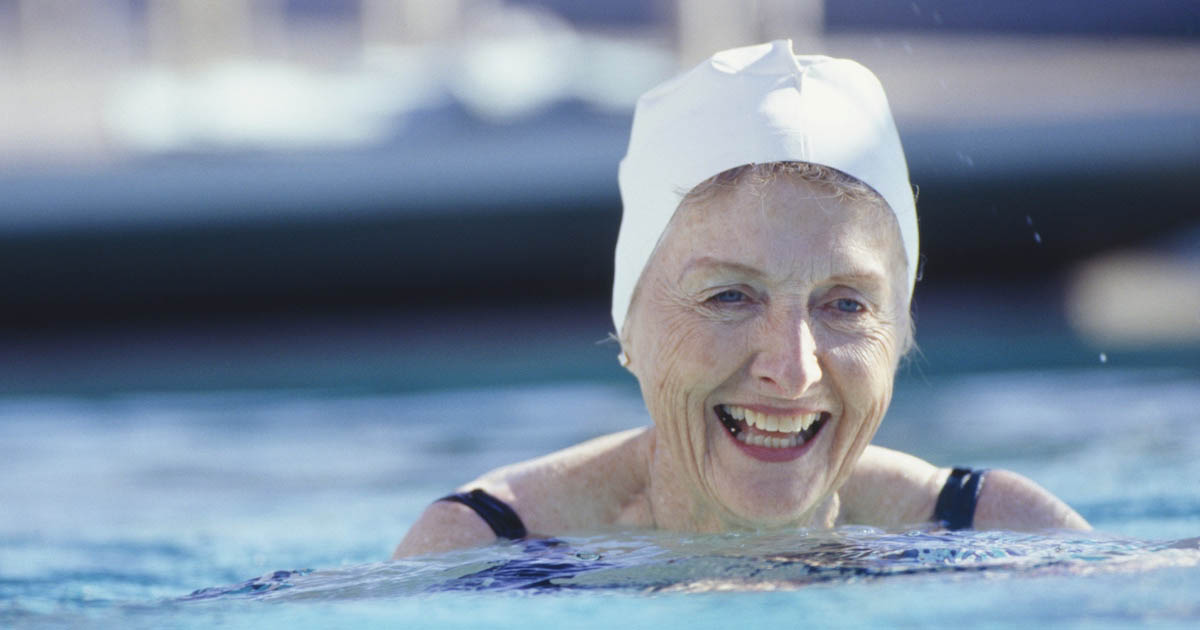 A woman is swimming in a pool